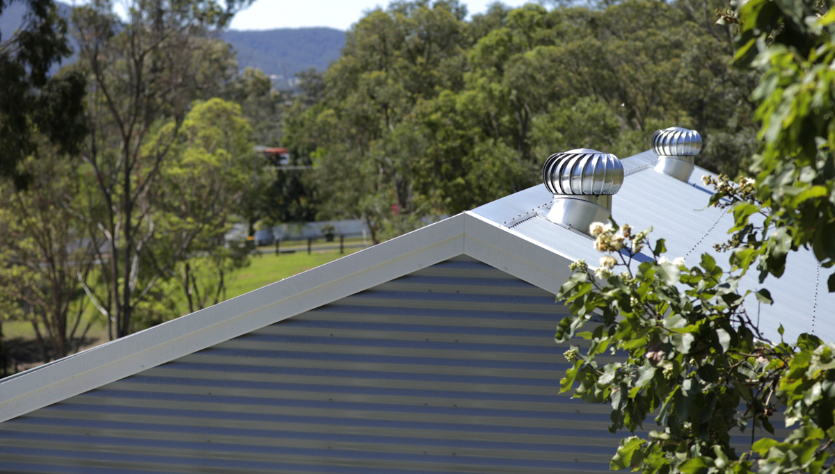 Corrugated shed roof featuring whirlybirds
