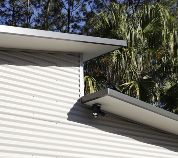 Corrugated cladding on a skillion shed with lean-to